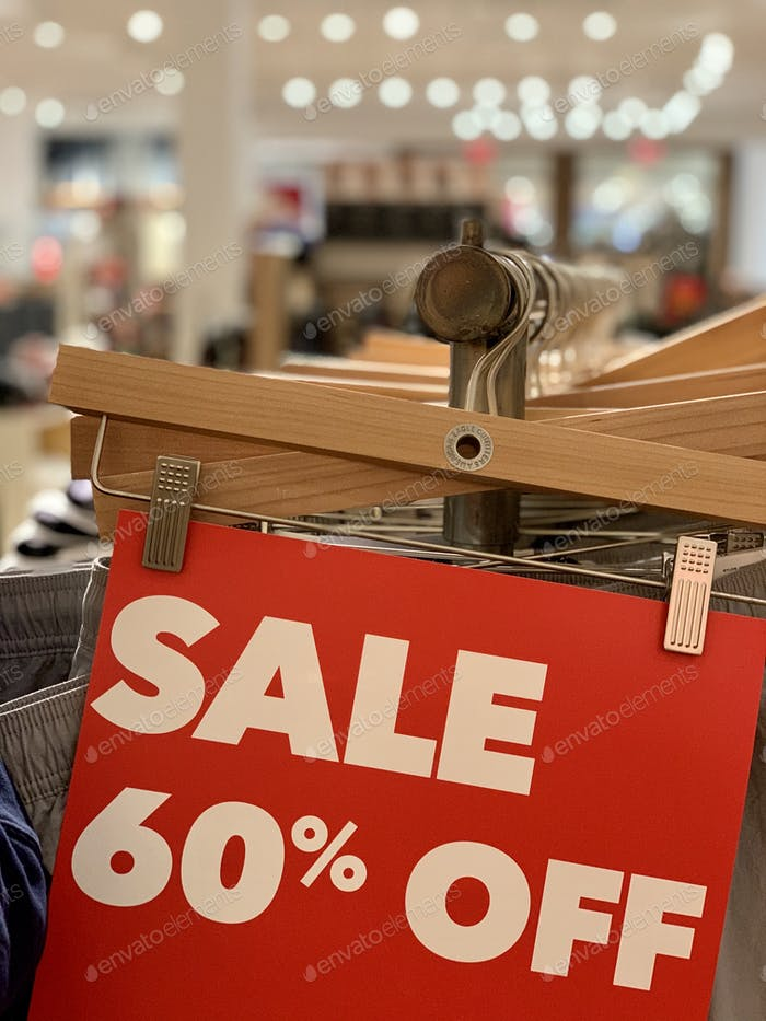 Final clearance everywhere! A red sale sign of 60%  off at the retail store.
