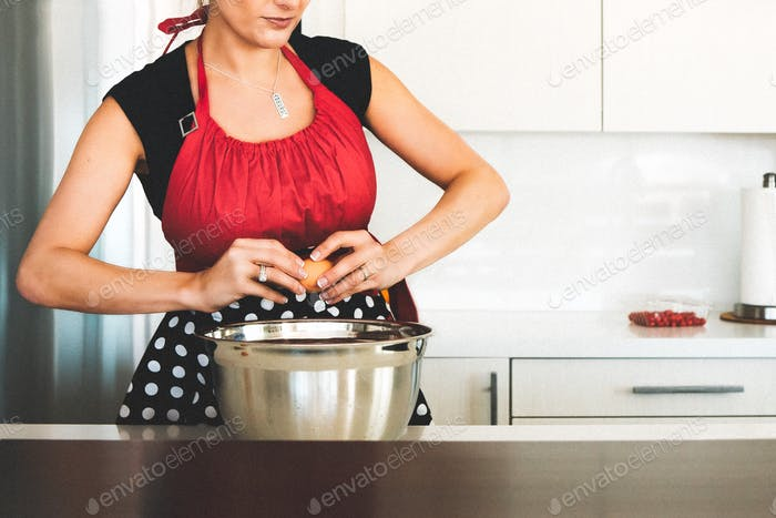 Woman in retro apron baking