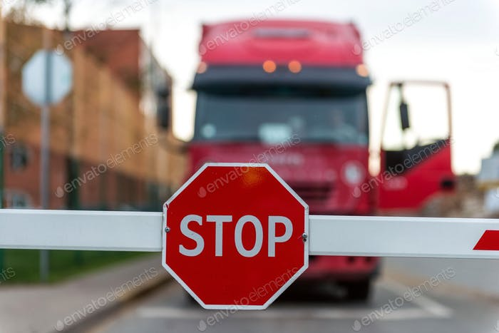 Truck standing at the barrier with a STOP sign.  ❤️  nominated 💔