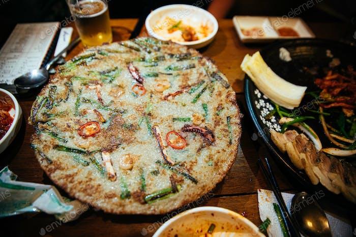 close up of Korean seafood pancake at a Korean restaurant