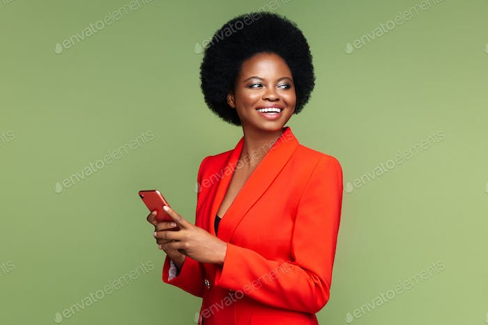Successful african businesswoman with smartphone look aside with confident happy smile isolated