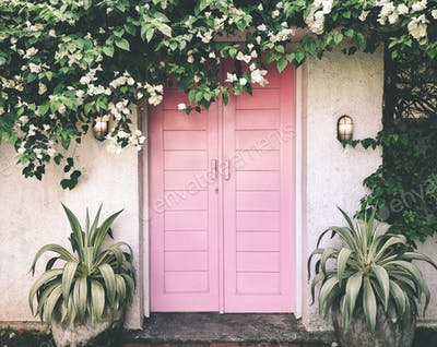 Pink door cover by the flowers