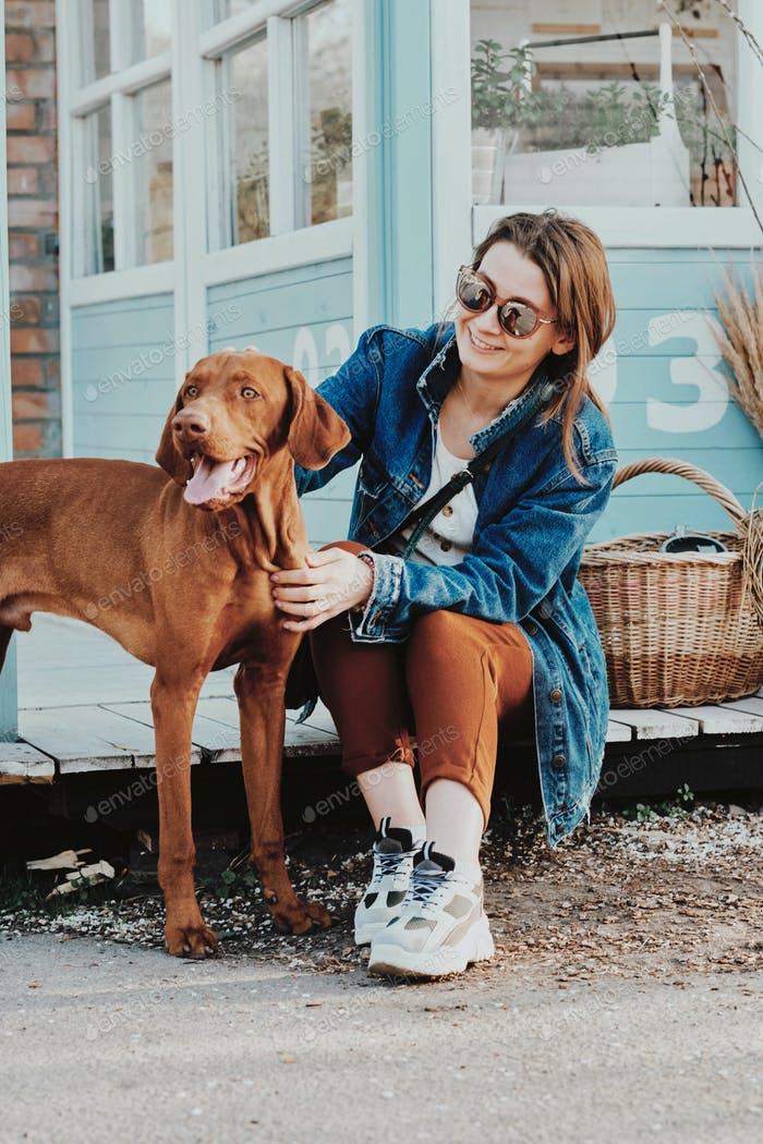 Smiling girl sitting with dog
