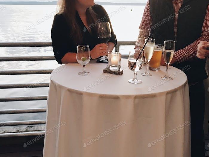 Enjoying drinks with friends overlooking the ocean