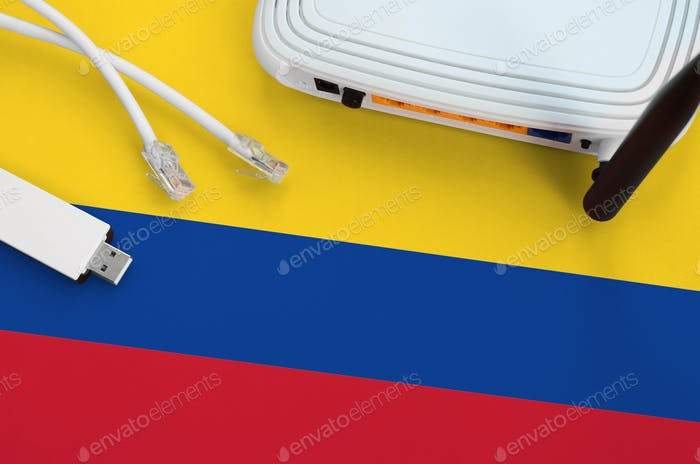 Colombia flag depicted on table with internet rj45 cable, wireless usb wi-fi adapter and router