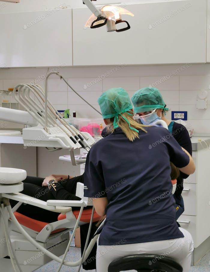 Dentists at work. At the dentist, job, profession, medical, health.