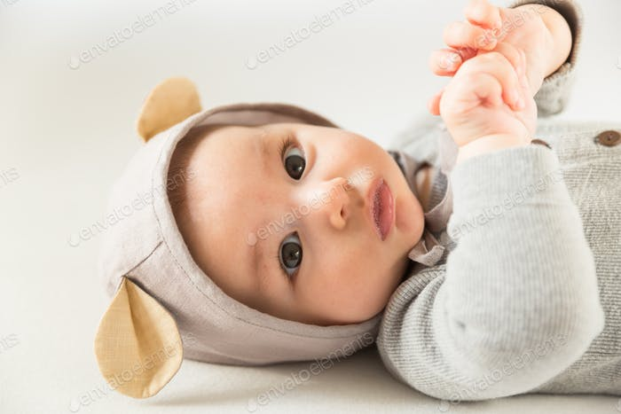 A cute baby wearing mouse ears
