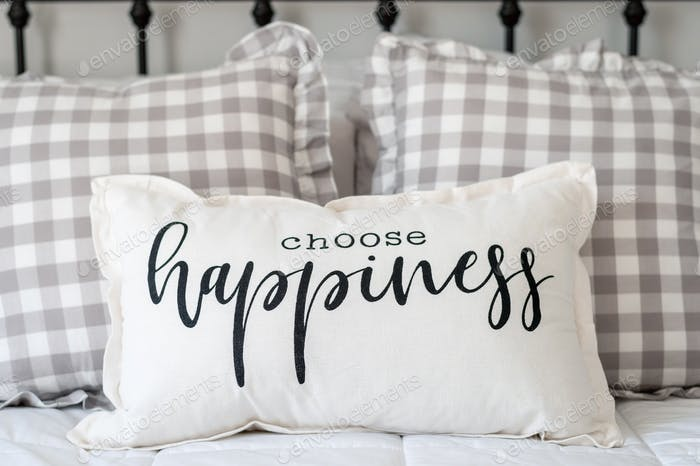 Pillow that says Choose Happiness