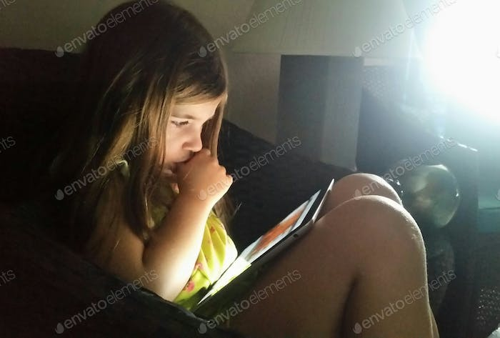 Little girl learning from mobile device...