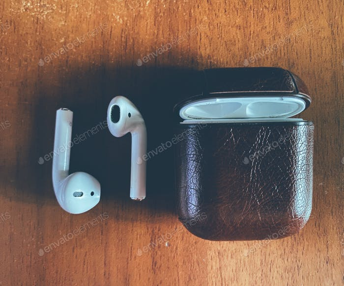 Close up of Airpods and case