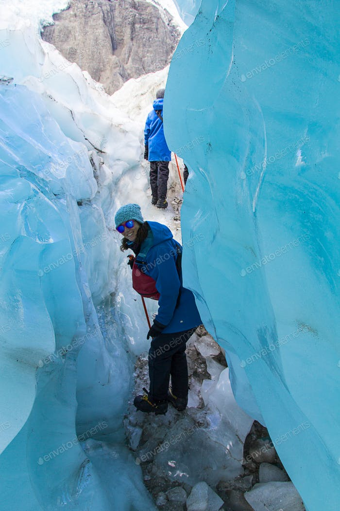 Woman hikking on the Franz Josef Glacier, trekking, people traveling, adventure, new zealand