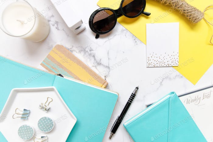 Desktop work and office flatlay with white, blue and yellow accents