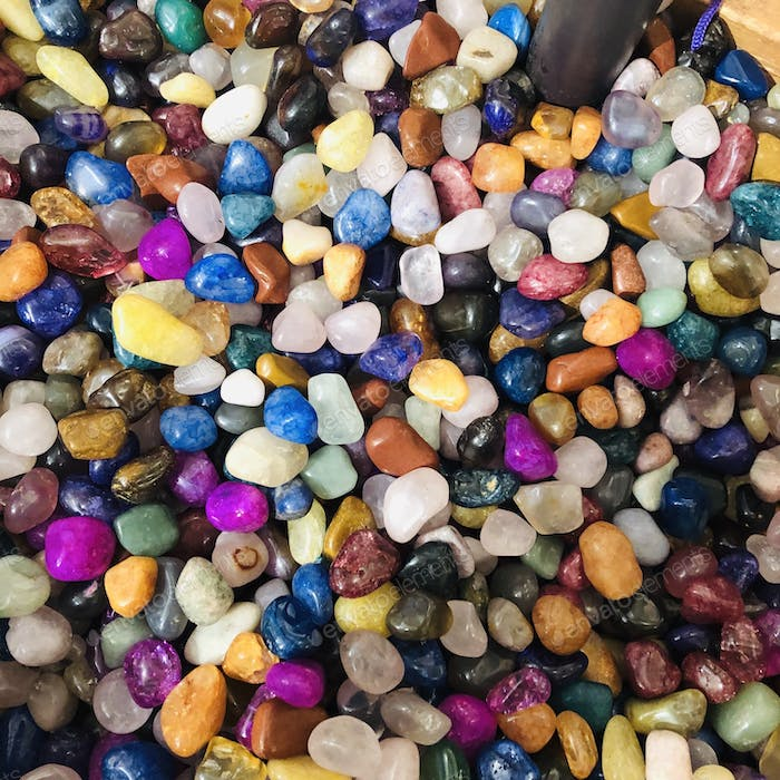 Mixtures of different coloured gems and stones