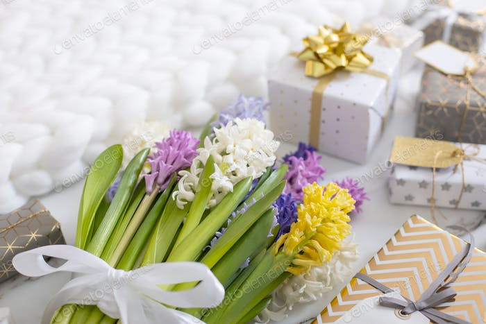 trendy composition with festive wrapped gift boxes ribbon bow decorated by bloom flowers