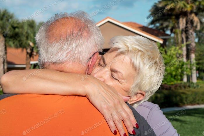 Senior adult couple hugging