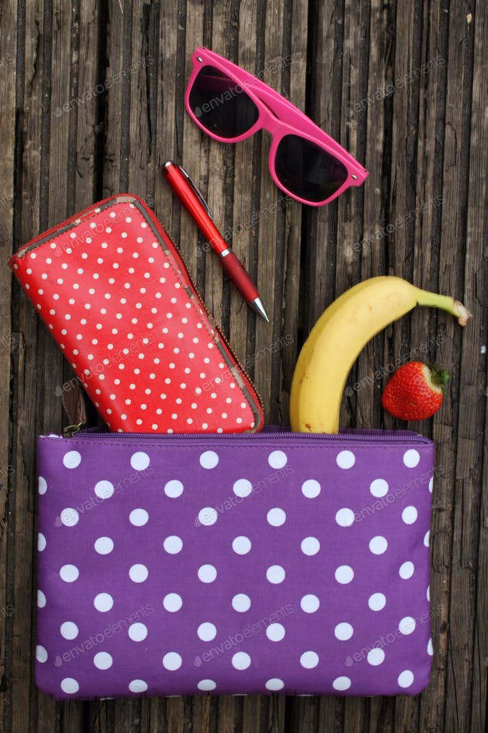Wallet and snacks in a spotty purse