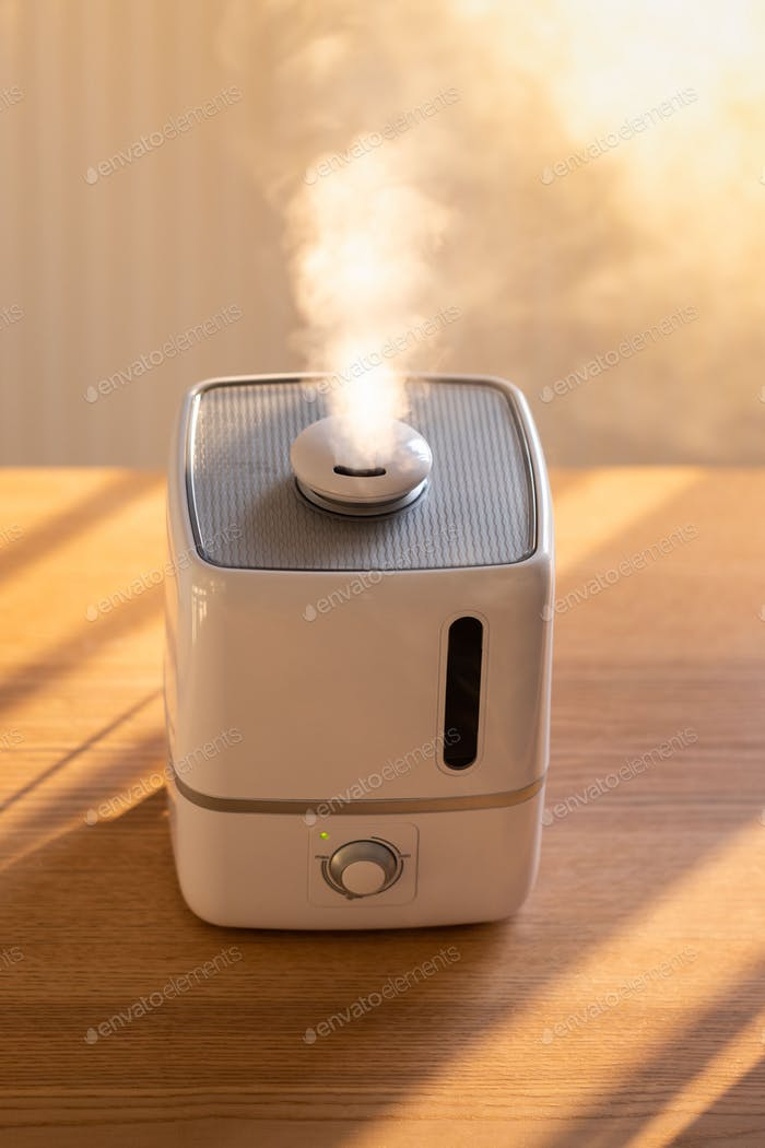 Air humidifier on the table at home during heating period in winter season