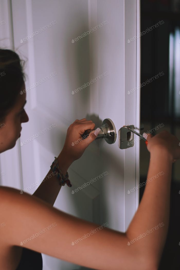 Young woman is fixing or installing a door handle  ✨NOMINATED✨