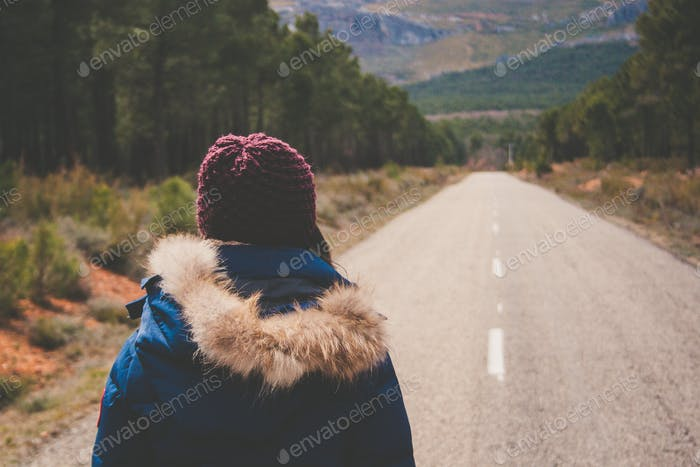 Woman walking. Thoughtful. Nature. Road. Coat. Clothes.