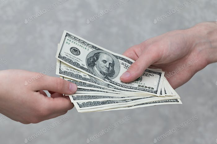 Giving money from hand to hand