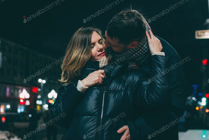 Real couple in love, winter romance in the city