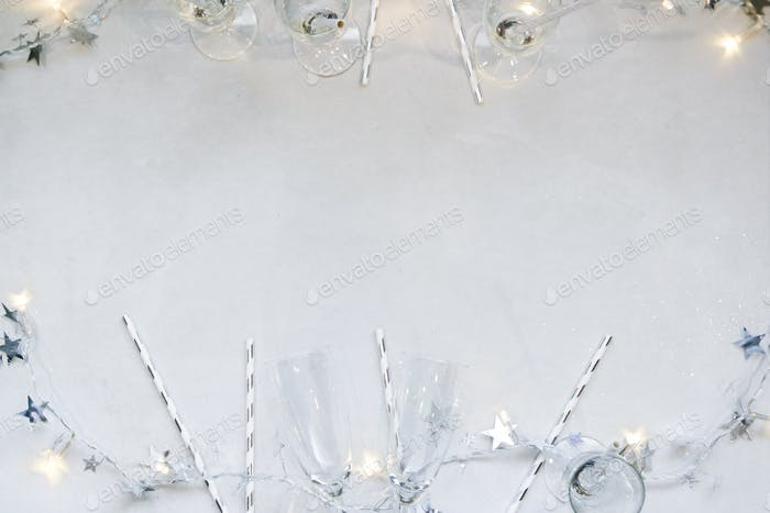 Silver and white champagne flute flat lay
