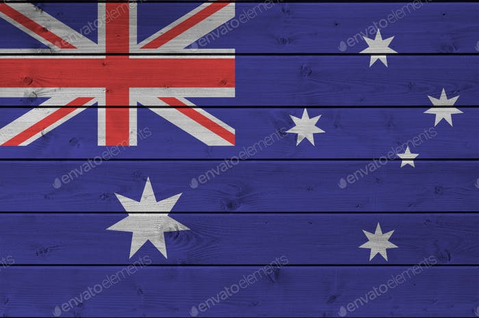 Australia flag depicted in bright paint colors on old wooden wall close up