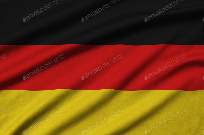 Germany flag  is depicted on a sports cloth fabric with many folds. Sport team waving banner