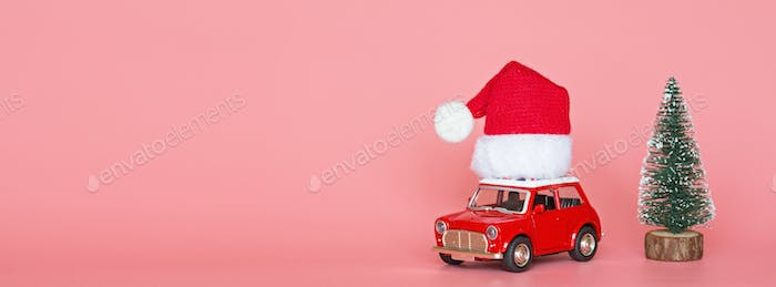 Horizontal long banner for web design with copy space of Christmas delivery car on pink background