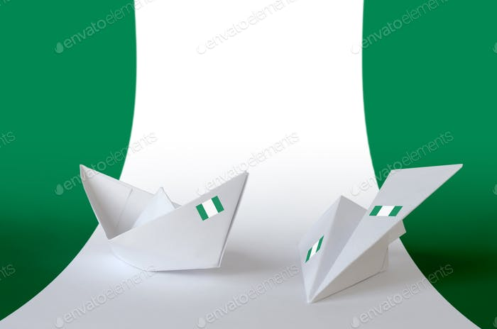 Nigeria flag depicted on paper origami airplane and boat. Oriental handmade arts concept