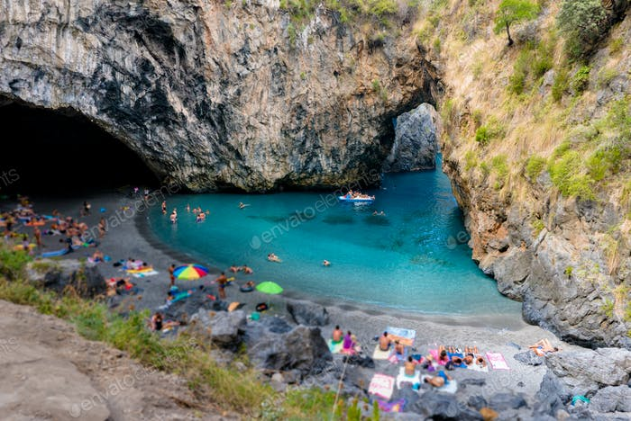 Italian calabrian ionian beach called arcomagno with natural rock arch and turquoise sea