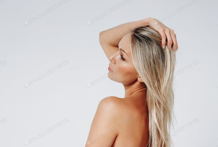 Blonde hair sensitive woman 35 year plus from behind close up beauty portrait isolated on the white