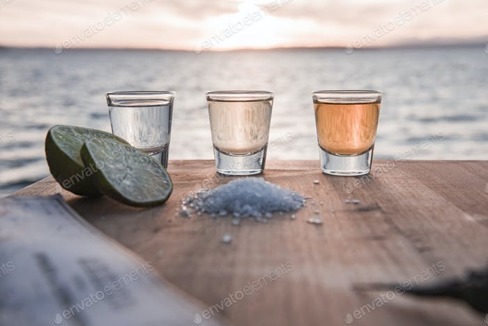 Shots of tequila at sunset