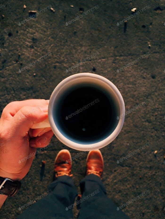 Man holding coffee mug.