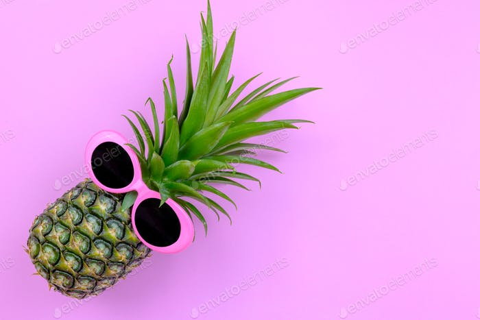 Fashion Hipster Pineapple on color background