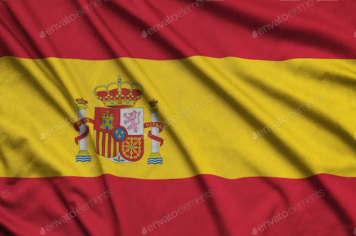 Spain flag  is depicted on a sports cloth fabric with many folds. Sport team waving banner