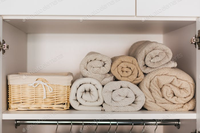 Shelf with towels in the closet. Pastel colors. Room concept