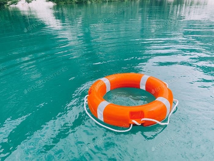 Safety buoy on emerald green water