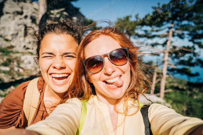 Friends making selfie at the mountain.