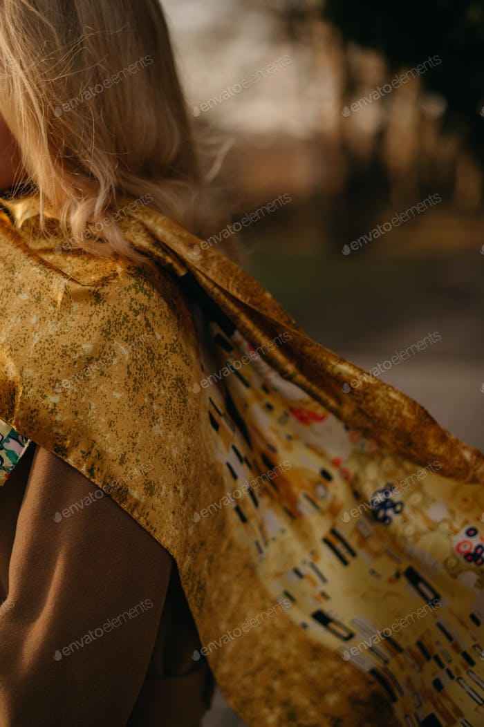 yellow and orange scarf with print on woman