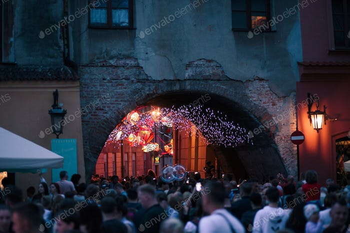 Old town in Lublin. People spending evening in downtown