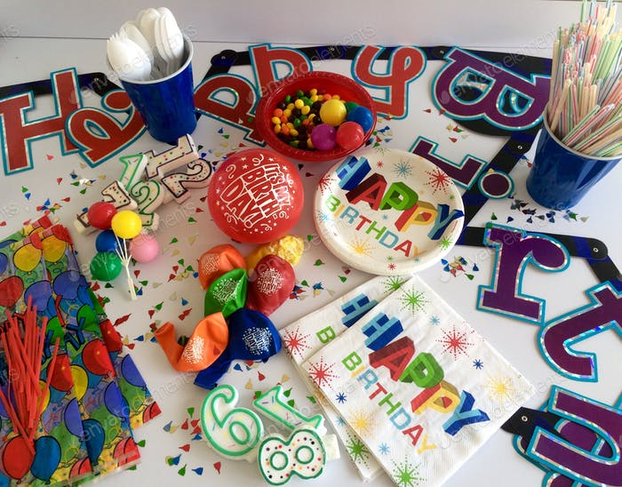 Flat lay of bright colorful birthday party supplies and decorations. Celebrations.