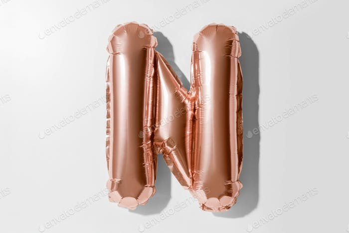 Letter N, Rose gold foil balloon alphabet isolated on a white background with Clipping Path