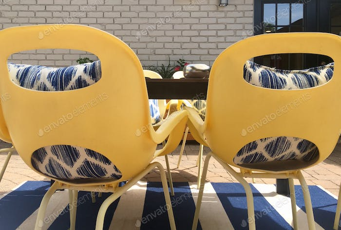 Yellow and blue furniture outdoor living space