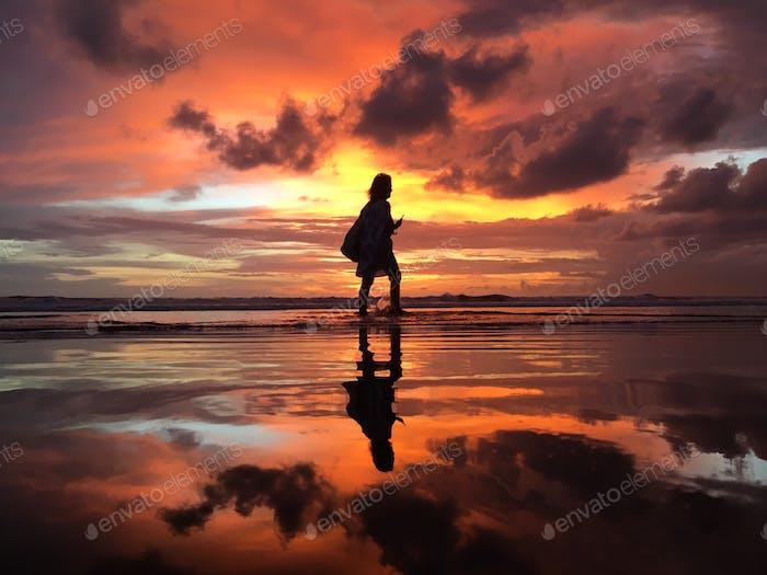 A sunset stroll along the beach.