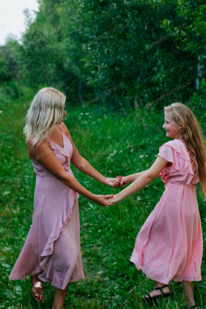 mom and teenage daughter dancing