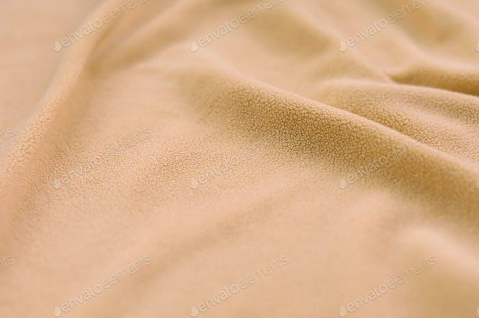 The blanket of furry orange fleece fabric