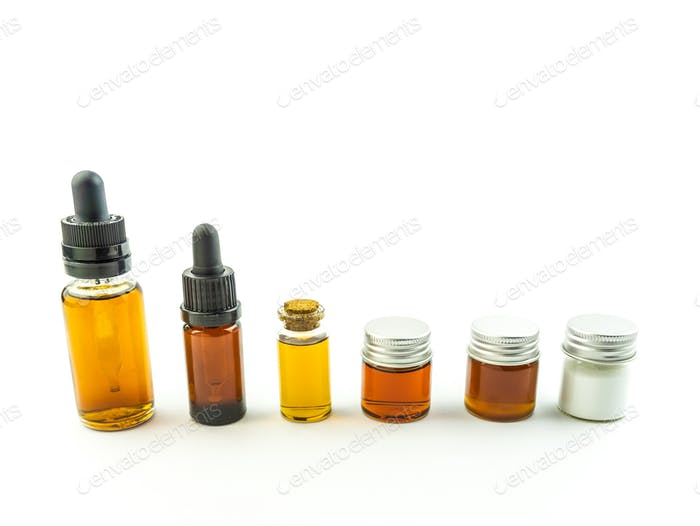Bottles with various full spectrum cannabis oils and Crystals isolate