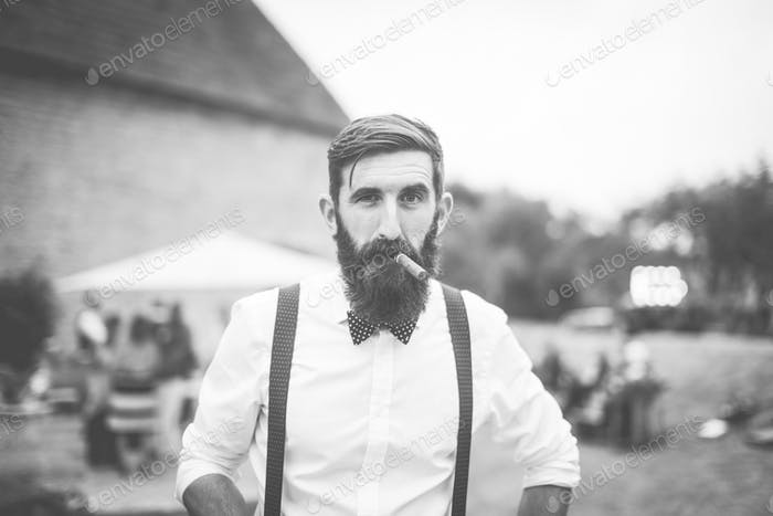 Wedding attire: beard, bow tie & braces.