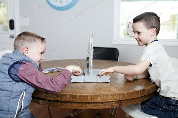 boy playing a game of battleship